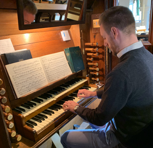 Organ being played at Holy Trinity